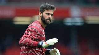 FILE - Liverpool's Brazilian goalkeeper Alisson Becker warms up ahead of the English Premier League football match between Liverpool and Burnley. Photo: Lindsey Parnaby/AFP