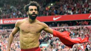 FILE - Liverpool's Mohamed Salah celebrates scoring their second goal in their Premier League game against Crystal Palace at Anfield in Liverpool. Photo: Peter Powell/Reuters