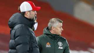 FILE - Manchester United manager Ole Gunnar Solskjaer with Liverpool counterpart Jurgen Klopp during a Premier League game. Photo: Phil Noble/Reuters