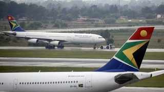 FILE PHOTO: A South African Airways (SAA) plane is towed at O.R. Tambo International Airport in Johannesburg