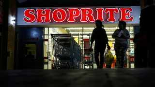 FILE PHOTO: Shoppers leave the Shoprite store in Daveyton. Shoprite Holdings reported a decline of 14.3 percent decline in trading profit to R6.9 billion for the year to end June.