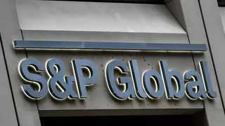 FILE PHOTO: The S&P Global logo is displayed on its offices in the financial district in New York City
