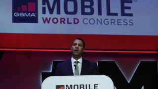 FILE PHOTO: U.S. Federal Communications Commissoner Ajit Pai delivers a keynote speech at the Mobile World Congress in Barcelona