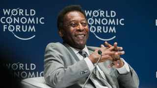 FILE - Pele smiles during the opening plenary at the World Economic Forum on Latin America in Sao Paulo, Brazil, on March 14, 2018. Photo: Benedikt von Loebell/AFP