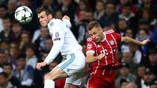 FILE - Real Madrid's Gareth Bale is challenged by Bayern Munich's Joshua Kimmich. Photo: Michael Dalder/Reuters