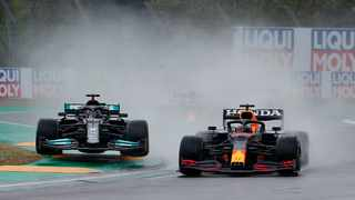 FILE - Red Bull's Max Verstappen and Mercedes' Lewis Hamilton in action during a race. Photo: Guglielmo Mangiapane/Reuters