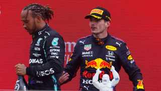 FILE - Red Bull's Max Verstappen and Mercedes' Lewis Hamilton on the podium. Photo: Eric Gaillard/Reuters