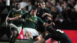 FILE - South Africa's Bismarck Du Plessis (L) kicks the ball out of the hands of Andre Hore (R) of the New Zealand during their Tri-Nations match at Waikato Stadium in Hamilton on September 12, 2009. Photo: AFP