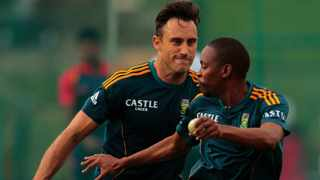 FILE - South African cricketer Faf du Plessis playfully chases teammate Aaron Phangiso during a practice session. Photo: Eranga Jayawardena/AP Photo
