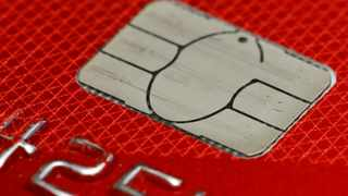 FILE- This June 10, 2015, file photo shows a chip credit card in Philadelphia. Consumers can now freeze their credit for free under a new federal law, which takes effect Friday, Sept. 21, 2018. A credit freeze restricts access to your credit file, essentially halting anyone from opening any new credit in your name. (AP Photo/Matt Rourke, File)