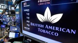 FILE - This is a Monday, July 24, 2017  file photo of the logo for British American Tobacco appears above a trading post on the floor of the New York Stock Exchange. British American Tobacco South Africa is concerned that the 8.5% increase in tobacco products will spike an increase in the illegal market. (AP Photo/Richard Drew/File)
