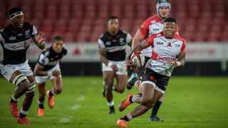 FILE - Wandisile Simelane of the Lions runs with the ball during their Currie Cup game against the Sharks at Ellis Park in December. Photo: Christiaan Kotze/BackpagePix