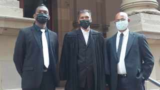 FROM left, Constable Tristan Pillay, attorney Ravindra Maniklall and Warrant Officer Theagasen Naidoo, outside the Durban High Court on Monday. Nadia Khan