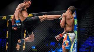 """Faeez """"The TroubleMaker' Jacobs - known for producing high-octane action - is seen here delivering an accurate flying kick to the head of Oumpie Sebeko at EF65. Photo: EFCWorldwide"""