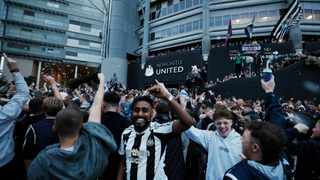 Fans react outside St James' Park after Newcastle United announced takeover. Photo: Lee Smith/Reuters