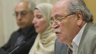 Fayez Sara (R) speaks with Ghied Al Hashmy (C) and Abdulbaset Sieda during a news conference by members of the Syrian opposition in Stockholm.