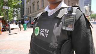 Feebearing - Cape Town - 151201 - Cape Town CCID introduce body-worn cameras to the CBD. CCID Officers with marked CCTV UNIT jackets patrol crime hotspots. Pictured: A CCID CCTV Unit Patrol officer in St. George's Mall on patrol. PICTURE: WILLEM LAW.