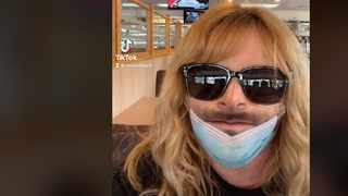 Female with a beard mask gets travellers in a tizz. Picture: screenshot/Tik Tok.
