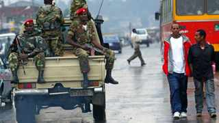 File-- In this file photo of June 10, 2005, Members of the Ethiopian army patrol the streets of Addis Ababa, Ethiopia, after recent clashes with protesters. Violent weekend clashes between protesters and security forces have claimed the lives of more than a dozen people across Ethiopia. The government announced Sunday evening that seven protesters died in the northern Amhara region's capital, Bahir Dar. Witnesses who spoke to The Associated Press anonymously for fear of reprisals said anti-riot police also used force Saturday to disperse hundreds of protesters in the capital, Addis Ababa.(AP Photo/Karel Prinsloo, file)