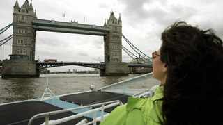 File photo: A visitor to London uses a river boat on the river Thames to enjoy the sights of London. Picture: AP