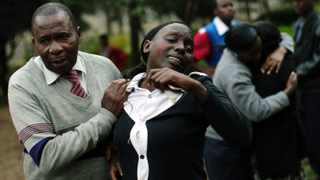 File photo: Relatives weep after identifying the body of Johnny Mutinda Musango, 48, one of the victims of al-Shabaab's attack on the Westgate mall.