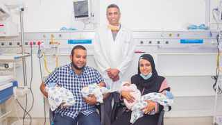 First-time parents Wasif Hussein and wife Ariffa with their babies and Dr Sagie Naidu. Picture: Supplied