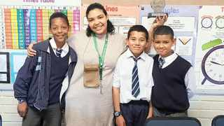 Floreat Primary School, Steenberg, pupils Diego Vorster, Keyon Johnson and Andre' Cerff earned R20 000 each by winning the 2019 Growsmart Mathematics Championship. They are pictured with teacher Nicole Thomas. Photo: Supplied