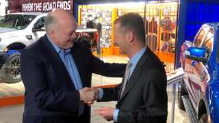Ford CEO Jim Hackett shakes hands with Volkswagen CEO Herbert Diess at the Detroit Auto Show earlier this year. Picture: Ben Klayman / Reuters.