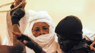 Former Chadian leader Hissène Habré is restrained as he is escorted to stand trial at the Palais de Justice in Dakar, Senegal, in 2015. Last May, he was found guilty of crimes against humanity, war crimes, and torture. Picture: EPA/STR