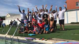 Former City law enforcement officer Keith Abrahams (centre in dark glasses) with one of his swimming classes at the Warobile Lifesaving Aquatics Academy. Picture: Supplied