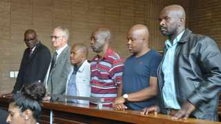 Former North West police deputy commissioner Major-General William Mpembe and five other policemen accused of murder related to the Marikana massacre. Picture: ANA