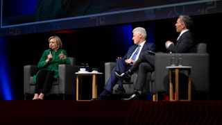 Former US Secretary of State, Hillary Clinton (left), former US President Bill Clinton (middle), and Discovery chief executive Adrian Gore (right) at the Discovery Leadership Summit in Johannesburg on Thursday Pic: Discovery/Supplied.