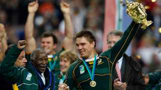 Former president Thabo Mbeki stands next to John Smit as he lifts the Rugby World Cup in 2007. Photo: Charles Platiau/Reuters