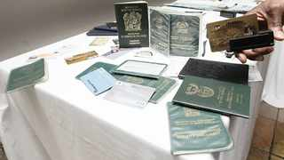 Fraudulent ID documents and passports which were confiscated from various FNB banks, photographed during a discussion on the latest card fraud trends held in Sandton. Picture: Leon Nicholas African News Agency (ANA)