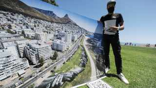 French-Swiss artist Saype brings his impressive 'Beyond Walls' series to SA, where he uses eco-friendly paint to create a unity embrace between two arms, highlighting solidarity and peace. Picture: Armand Hough/African News Agency (ANA)