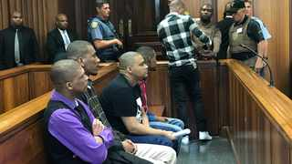 From left, Jermaine Mitchell, Glynn Carelson, Wendell Petersen, Robin Taylor and Graham Kammies, charged with a 2015 triple murder pleaded not guilty to a string of charges in the Port Elizabeth High Court on Monday. Picture: Raahil Sain/ANA