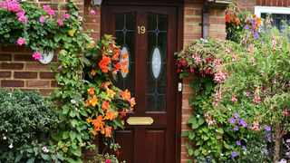Front gardens are a bridge between private and public life. Because they're visible to neighbours and passersby, they may be able to contribute to the wellbeing of the community, too, says the writer. Picture: Peter Holmes/Pixabay