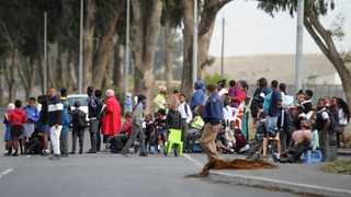 Frustrated Forest Village parents and the community protesting in Faure Road after Western Cape Department of Education failed to give them School. Picture: Ayanda Ndamane/African News Agency (ANA)