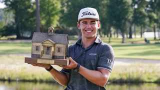 Garrick Higgo holds the trophy after winning the Palmetto Championship at Congaree golf tournament. Photo: David Yeazell-USA TODAY Sports