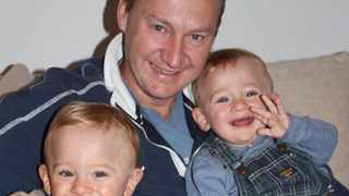 Gary Clarence with his 3-year-old twins Ben and Max.