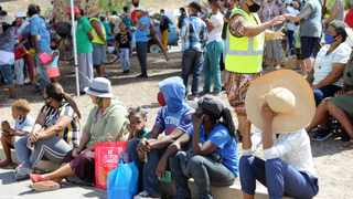 Gift of the Givers distributing food parcels and sweet packs to kids in Touws River, Western Cape, as well as bulk food to the soup kitchen this week. Picture: African News Agency (ANA)