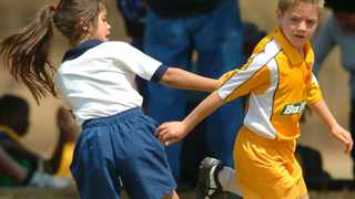 Girls play football at school. Due to Covid-19 contact sports in schools have been stopped with immediate effect. Picture: African News Agency (ANA)