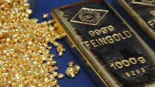 Gold inched lower on Tuesday as optimism over an effective Covid-19 vaccine offset concerns facing its eventual rollout. Photo: Reuters