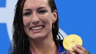 Gold medallist South Africa's Tatjana Schoenmaker poses on the podium after the final of the women's 200m breaststroke at the Tokyo Olympics. Photo: Jonathan Nackstand/AFP