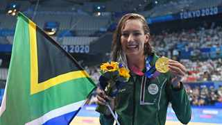 Gold medallist South Africa's Tatjana Schoenmaker poses with their medal after the final of the women's 200m breaststroke. Photo: AFP