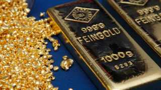 Gold prices rose on Friday due to a subdued dollar and as investors avoided riskier assets because of China's Evergrande saga, but looming interest rate hikes slowed bullion's advance. Photo: REUTERS/Heinz-Peter Bader