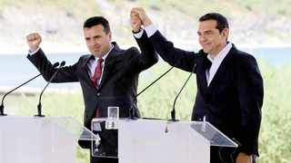 Greek Prime Minister Alexis Tsipras and Macedonian Prime Minister Zoran Zaev gesture before the signing of an accord to settle a long dispute over the former Yugoslav republic's name in the village of Psarades, in Prespes, Greece, on Sunday. Picture: Reuters