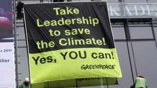 Greenpeace activist protest outside the venue of the Petersberg Climate Dialogue in Berlin.