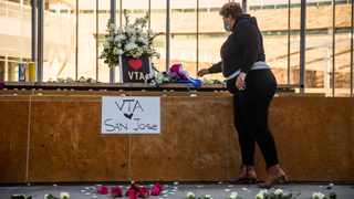HERO Tent President Kiana Simmons places a candle at a vigil organised by her group following the mass shooting at the Valley Transportation Authority (VTA) light-rail yard, outside City Hall in San Jose, California. Picture: Philip Pacheco / Getty Images via AFP