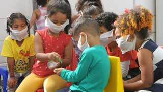 Happy Valley Daycare in Strandfontein where Children are engaging in good hand sanitising practices and wearing makeshift masks made from wet wipes. Picture: Tracey Adams/African News Agency (ANA)